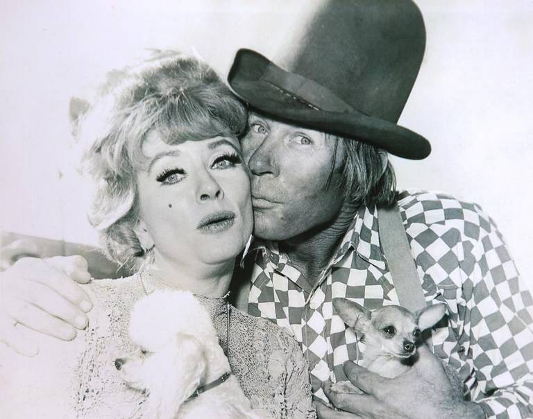 "A photo of Wilbur Plaugher with Miss Kitty on ""Gunsmoke."""