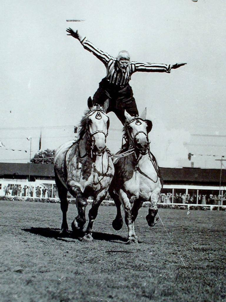 Wilbur Plaugher performing during a rodeo - Riding Roman