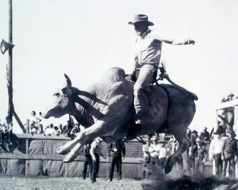 Wilbur Plaugher performs in a past rodeo